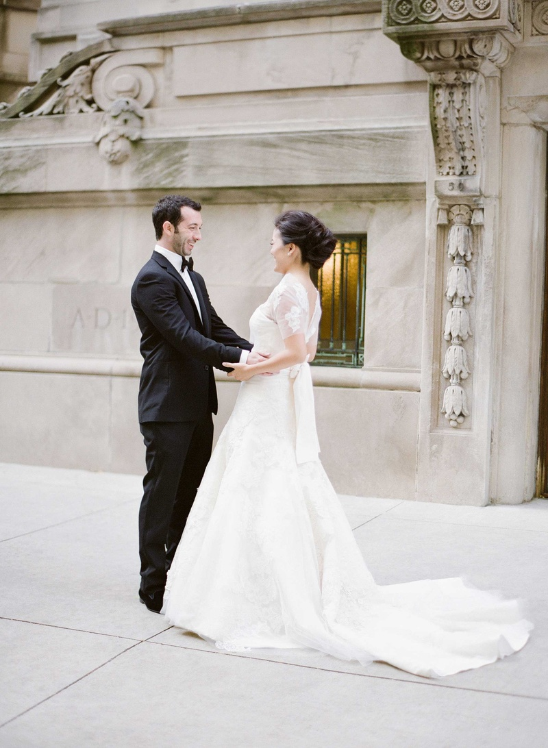 Bride and groom smile at each other during first look in Chicago wedding photo