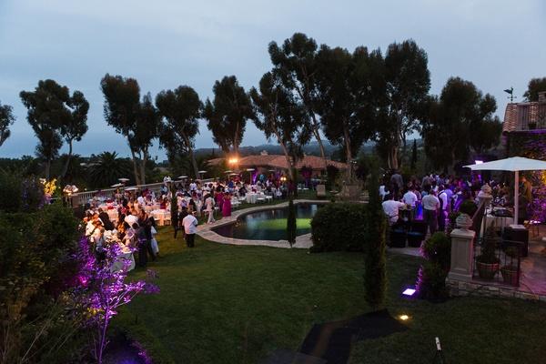 outdoor reception around pool overlooking ocean