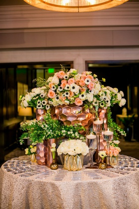 wedding reception round table acrylic escort cards gold rose gold honeycomb vases anemone rose