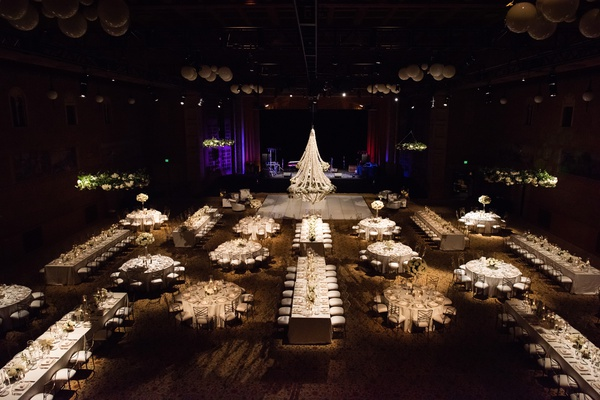 view from above indoor wedding reception with each table carefully lit
