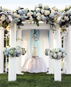 Cake gazebo with floral header and cuffs