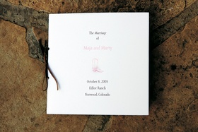 Ceremony program with pink cowboy boot tied with leather