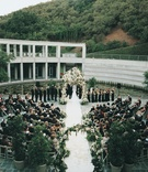ceremony in museum courtyard with mountain background