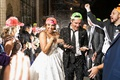 bride and groom exit with confetti thrown wearing neon trucker hats