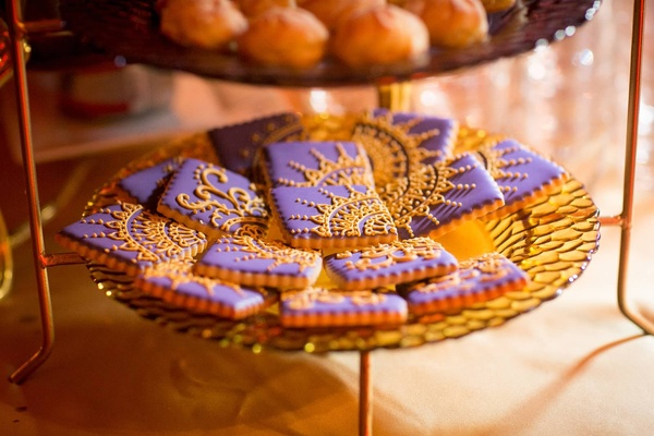 henna patterned cookies in purple and gold