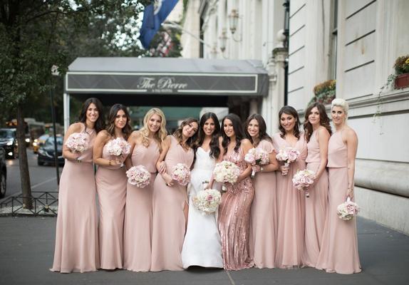 Bride in strapless monique lhuillier bridesmaids in pink monique lhuillier blush dresses the pierre