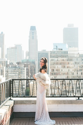 Bride in Naeem Khan wedding dress Chicago skyline fur stole wrap bridal portrait