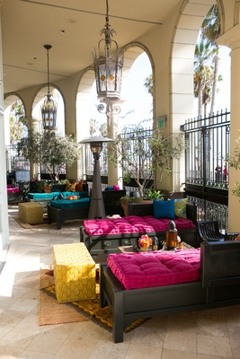 Moroccan-themed engagement party with hot pink, blue cushions, bright throw pillows, Casa del Mar