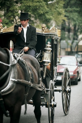Vintage transportation driver in top hat