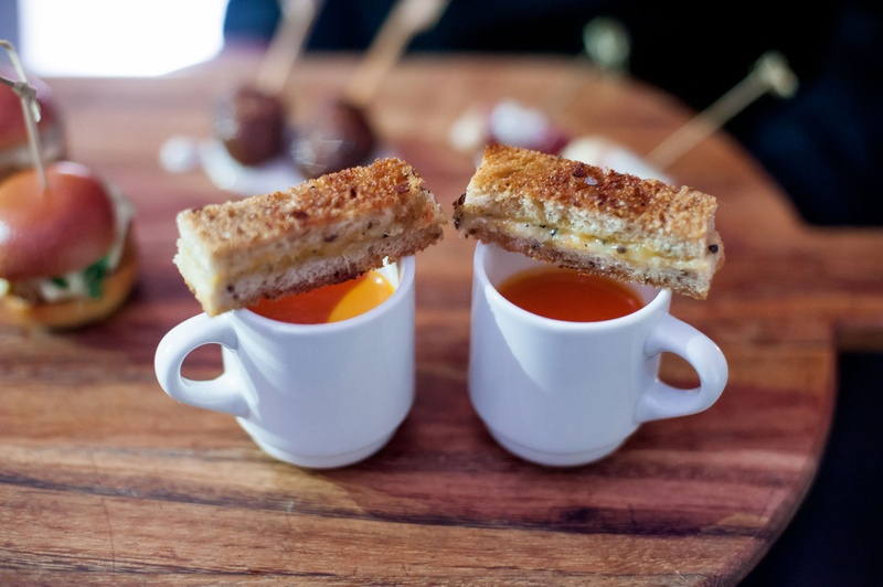 Wedding cocktail hour hors d'oeuvres appetizer mug of tomato soup with slice of grilled cheese