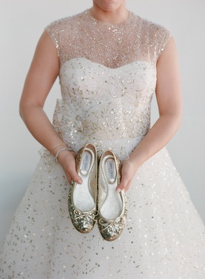 Bride holding gold sequin Jimmy Choo flats