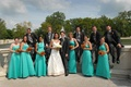 Bride and groom with bridesmaids in long teal dresses and groomsmen in tails