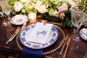 wedding reception head table wood greenery blue white china laser cut place card name