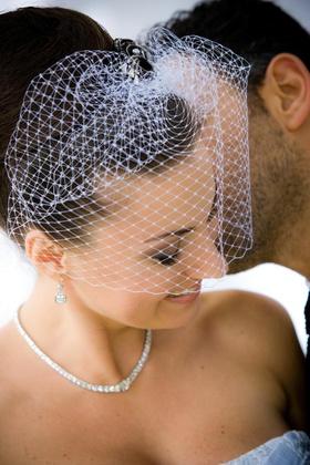 Bride wearing short white French net veil
