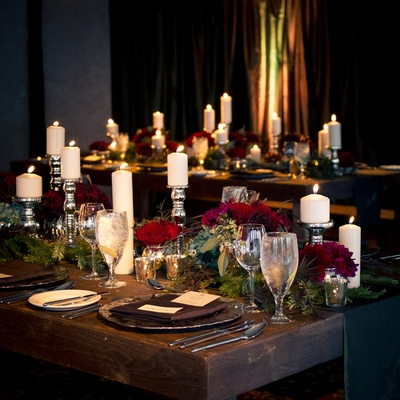 Silver candlesticks and winter-inspired florals