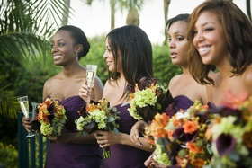African American bridesmaids holding bouquets and champagne