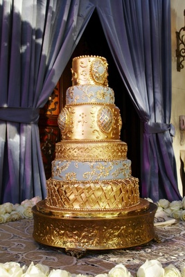Blue and gold romantic six layer wedding cake
