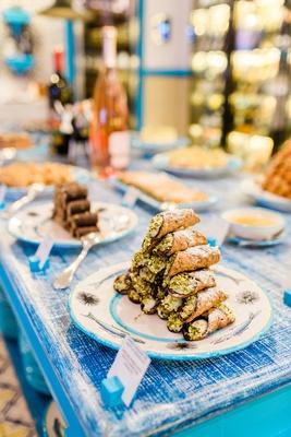 pyramid of cannoli at dessert table at destination wedding in Capri
