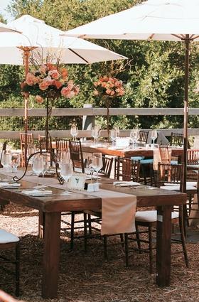 Ojai rustic wedding decorations under umbrellas