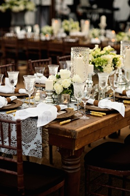 Wedding reception with country table, damask runner with brown print, white roses, candles