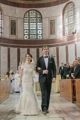 bride and groom walk down aisle in italian church