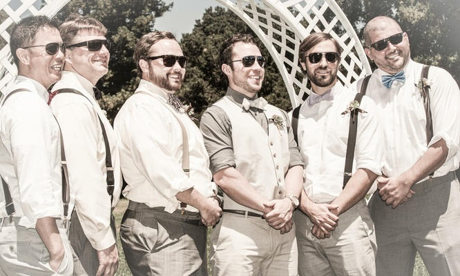 Casual groomsmen in suspenders and bow ties