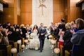 Bride and groom walking up church aisle after wedding