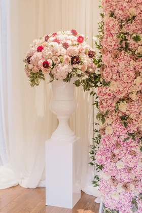 Wedding ceremony decor white urn and riser with greenery pink flowers burgundy blooms flower wall