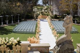 wedding ceremony outdoor monarch beach resort pampas grass aisle runner statue stone gazebo heaters
