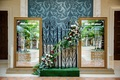 wedding reception seating chart mirror gold frames iron gates garland greenery burgundy pink white
