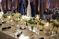 wedding reception long table gold white linen gold candleholder vase anemone rose hydrangea decor