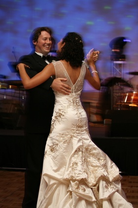 Bride's Reem Acra gown with pickup skirt and gold embroidery