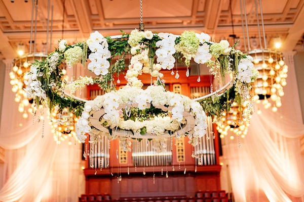 two-tiered floral chandelier with orchids, hydrangeas, and greenery
