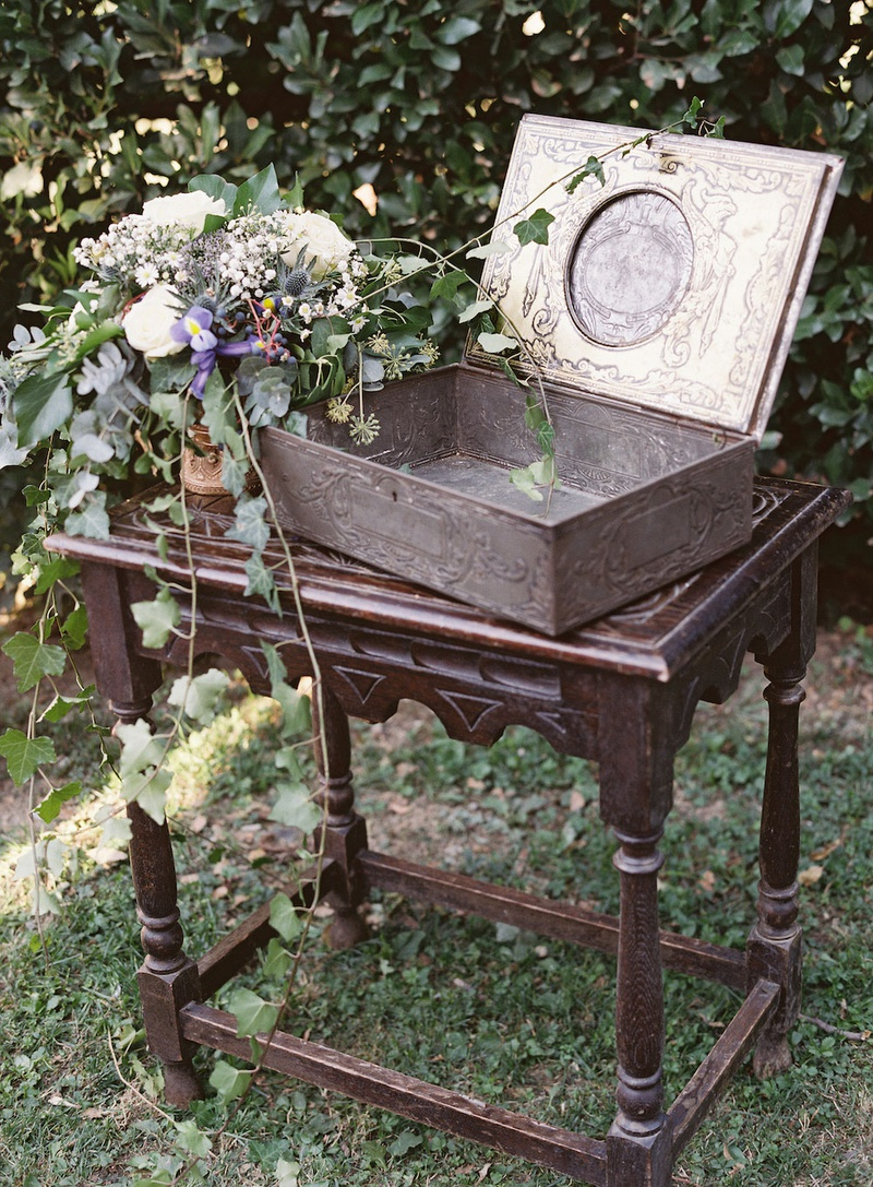 wedding card and gift display at outdoor reception greenery purple white flowers antique dark wood