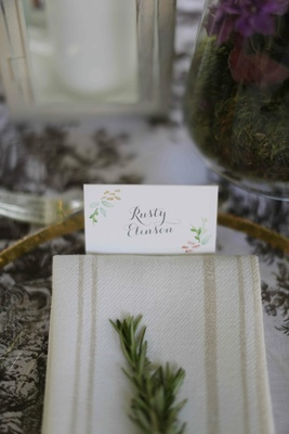 Calligraphy escort card with colorful watercolor painting