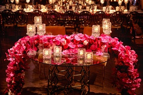 wedding reception sweetheart table crystal candle holder pink red rose orchid flower runner votives