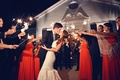 Bride in Ines Di Santo wedding dress kisses groom at sparkler exit