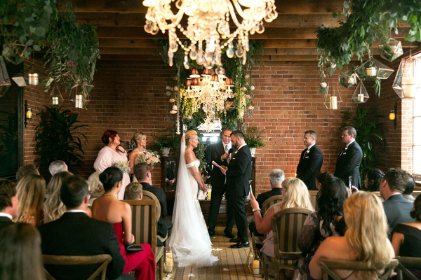 Wedding ceremony brick wall urban chic wood floor brittany daniel and adam touni actress wedding