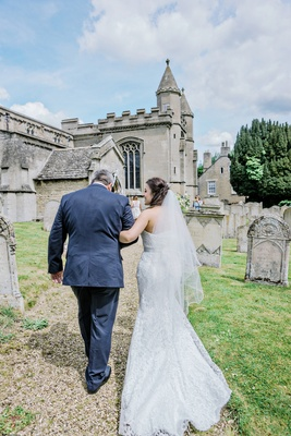 brides father walking her into church ceremony england english british wedding st andrews UK