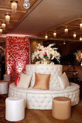White tufted round banquette with pillows