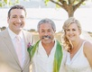 Bride and groom portrait with officiant from Hawaii