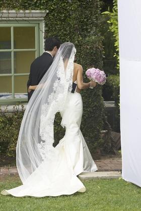 Bride wearing Tia Mazza mantilla veil