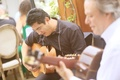 acoustic guitarist play during wedding reception dinner