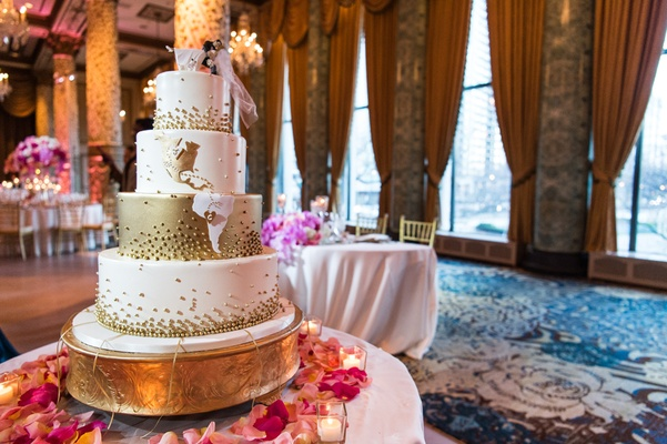 four tiered gold wedding cake, hearts at hometown, cake topper with groom dipping bride