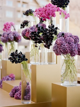 Wedding ceremony outdoor fall wedding ideas gold risers stage with purple flowers in vases