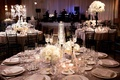 Textured tablecloths and white floral arrangements