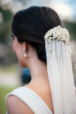Bride with updo and pearl earring wearing vintage antique veil wedding ideas lily of the valley