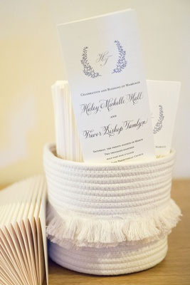 wedding ceremony programs monogram calligraphy in white robe basket with tassel fringe in middle