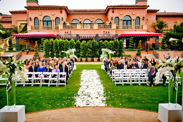 Petal-covered aisle with The Grand Del Mar as backdrop