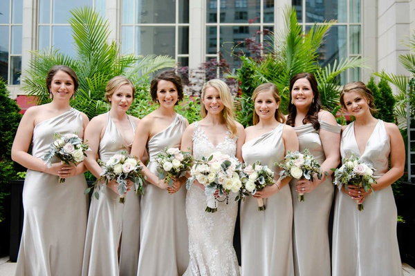 bride with bridesmaids in silver mismatched bridesmaid dresses necklines halter v neck one shoulder